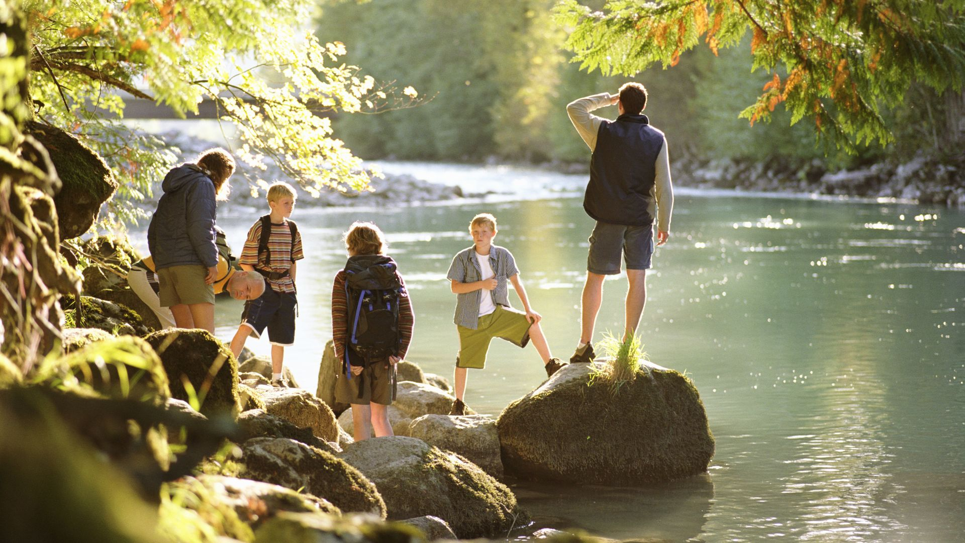 A Group Of People Standing In A River