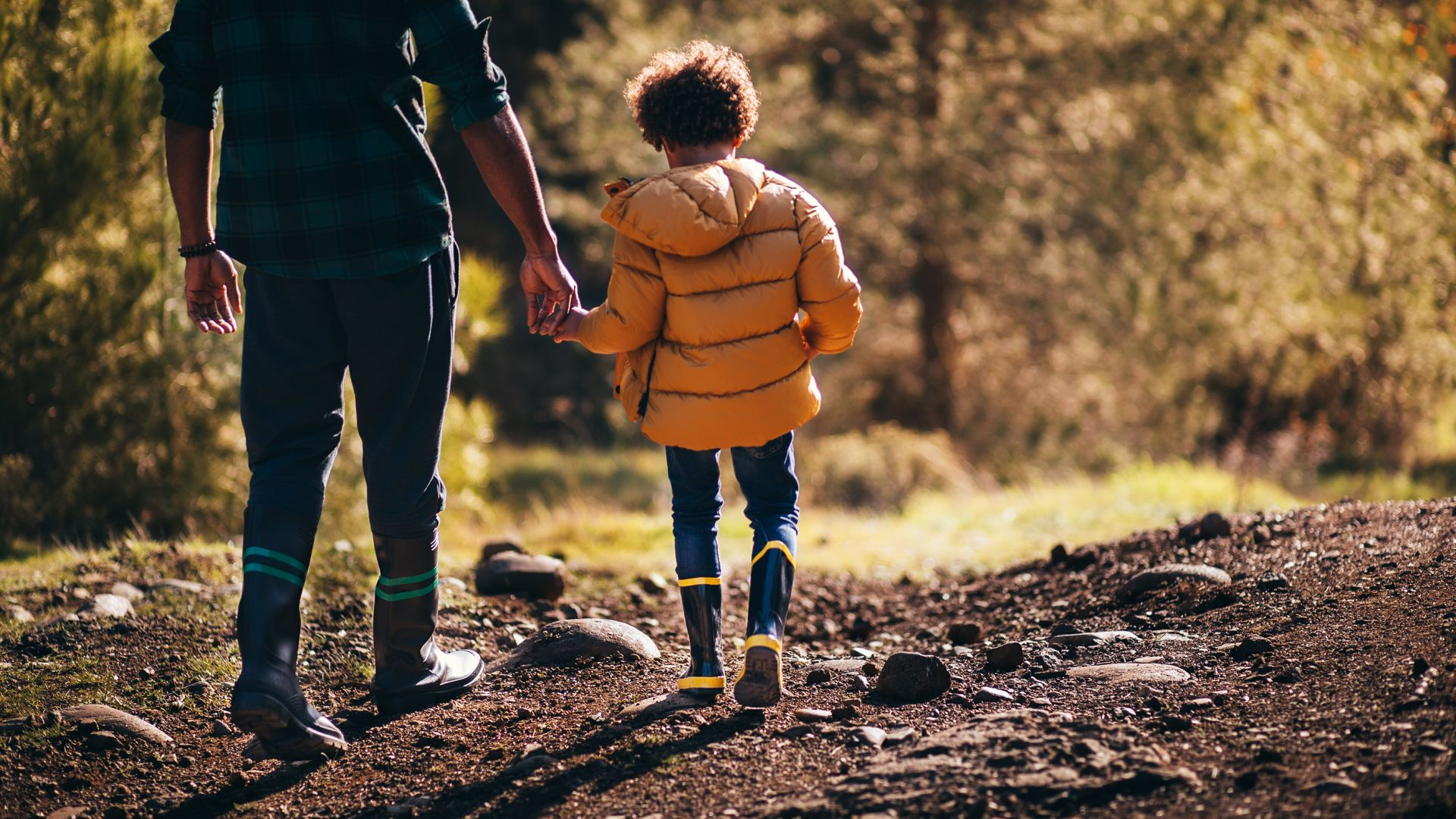A Little Boy Hiking with Dad